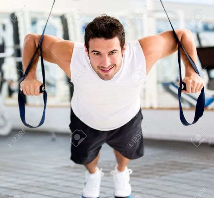 14710061-strong-handsome-man-exercising-at-the-gym-stock-photo-fitness